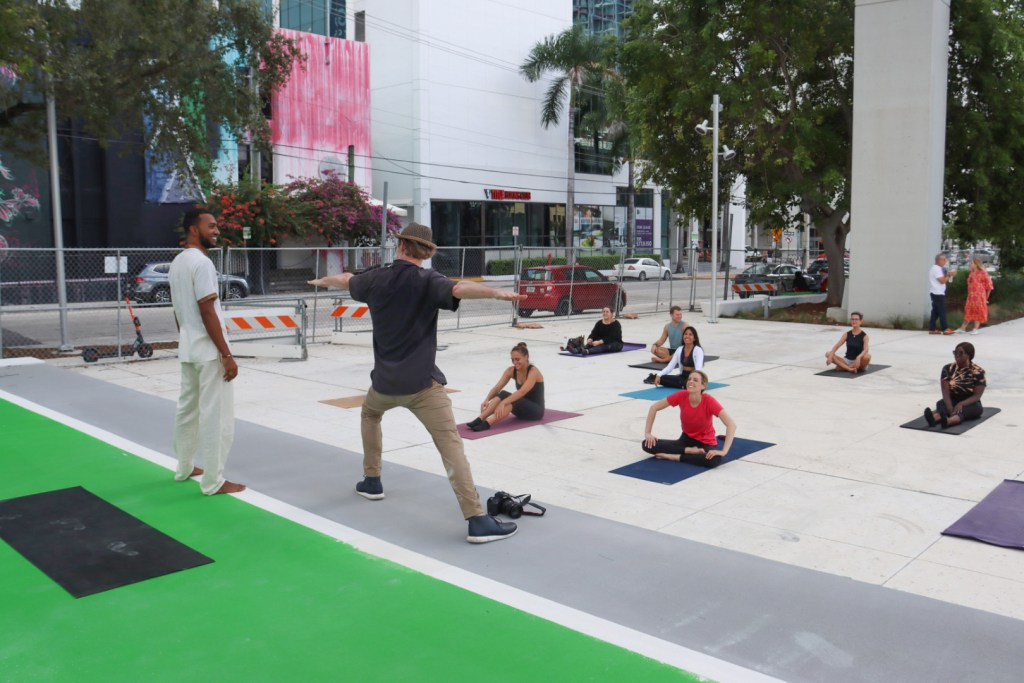 A yoga class taking place on The Underline.