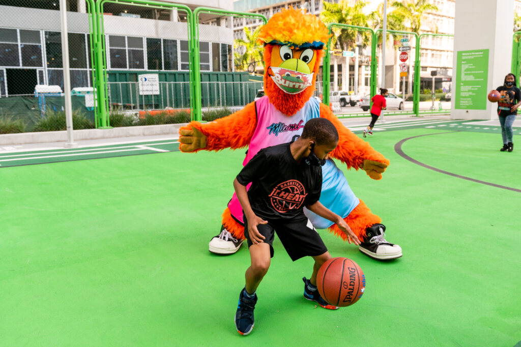 Bernie from the Miami HEAT playing with young boy
